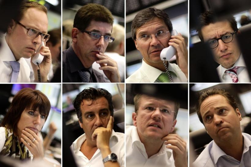 A combination of eight pictures shows share traders reacting in front of their monitors at Frankfurt's stock exchange