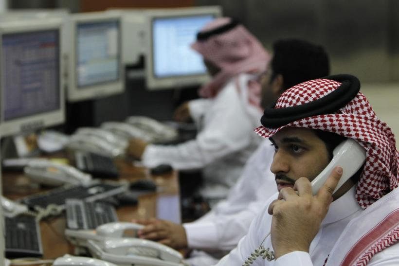 Saudi traders monitor stocks at the Saudi Investment Bank in Riyadh
