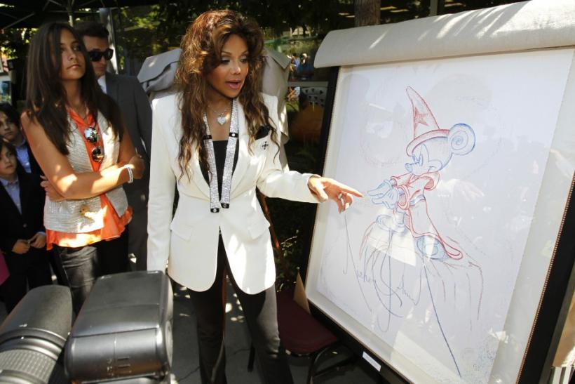 Paris-Michael Katherine Jackson (L), the daughter of late singer Michael Jackson, and her aunt La Toya Jackson unveil artwork created by the late Michael Jackson during a private ceremony at Children's Hospital in Los Angeles