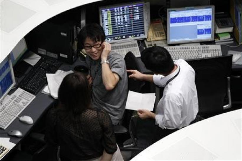 Employees of the Tokyo Stock Exchange (TSE) work at the bourse in Tokyo