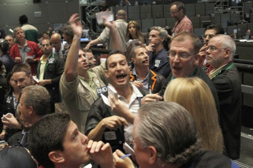 Traders signal orders at the CBOT in Chcago