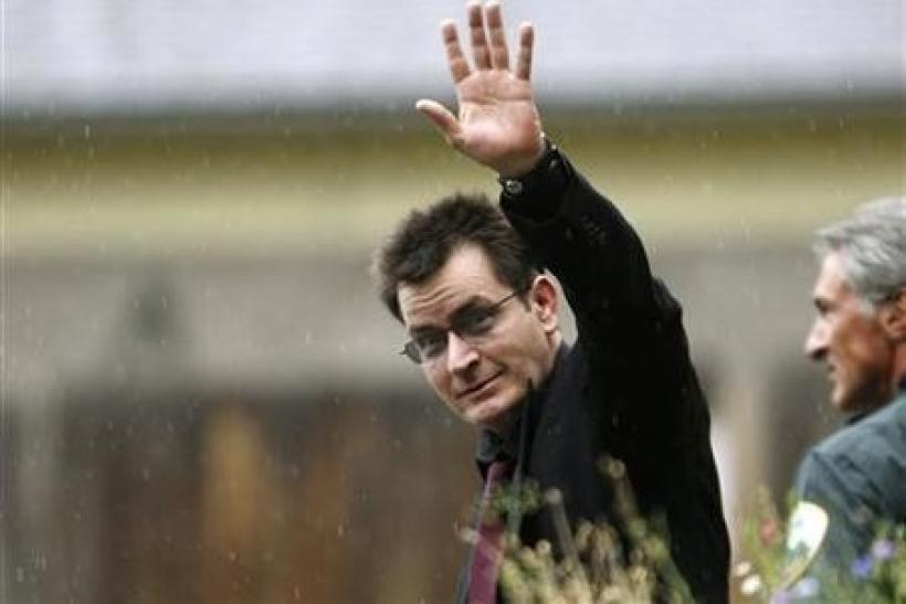 Actor Charlie Sheen gestures towards the media as he leaves the Pitkin County Courthouse after a sentencing hearing in Aspen, Colorado