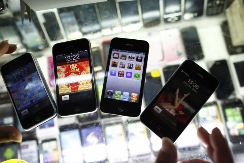 Fake iPhones are displayed at a mobile phone stall in Shanghai