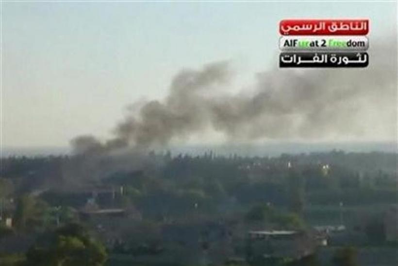 Smoke rises in the city of Deir Al Zour