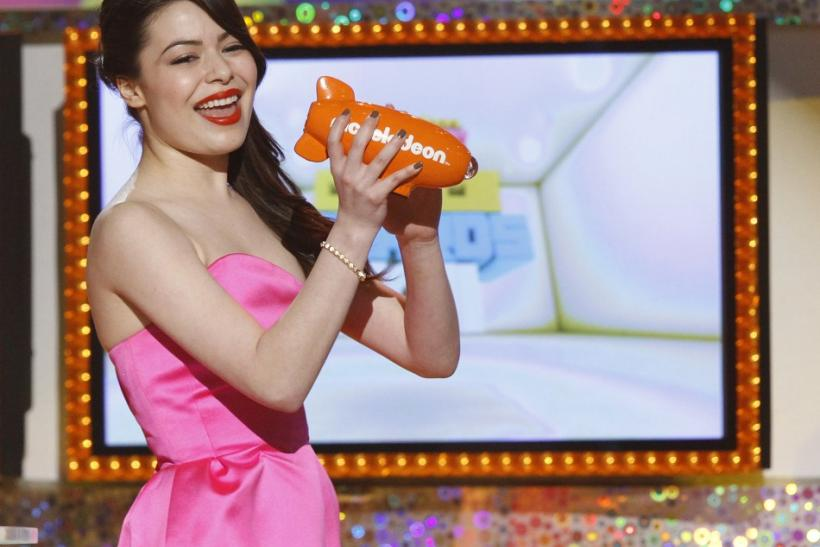 "Actress Miranda Cosgrove accepts the Favorite TV Show award for ""iCarly"" at the 24th annual Nickelodeon Kids' Choice Awards in Los Angeles"