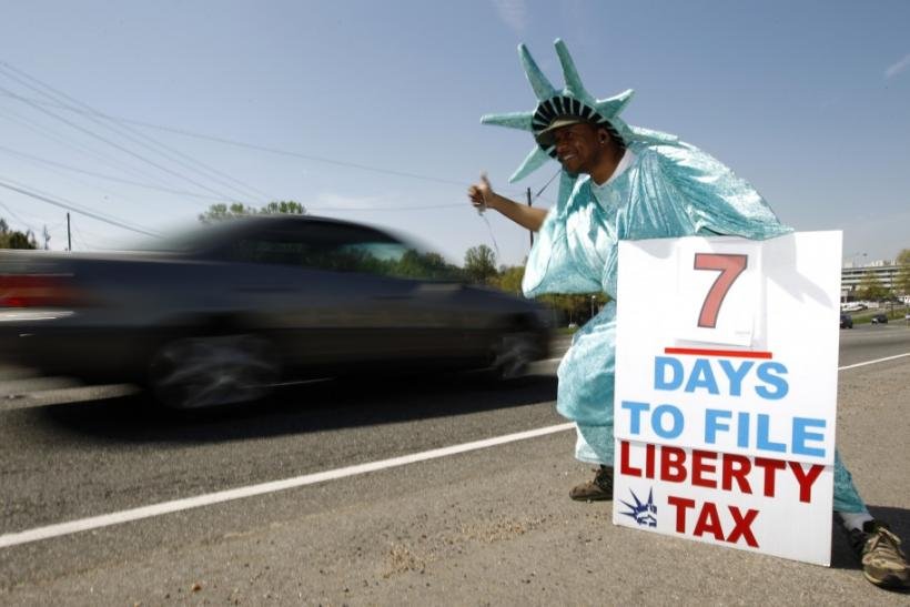 A man dressed as the statue of Liberty at a tax assistance business in northern Virginia