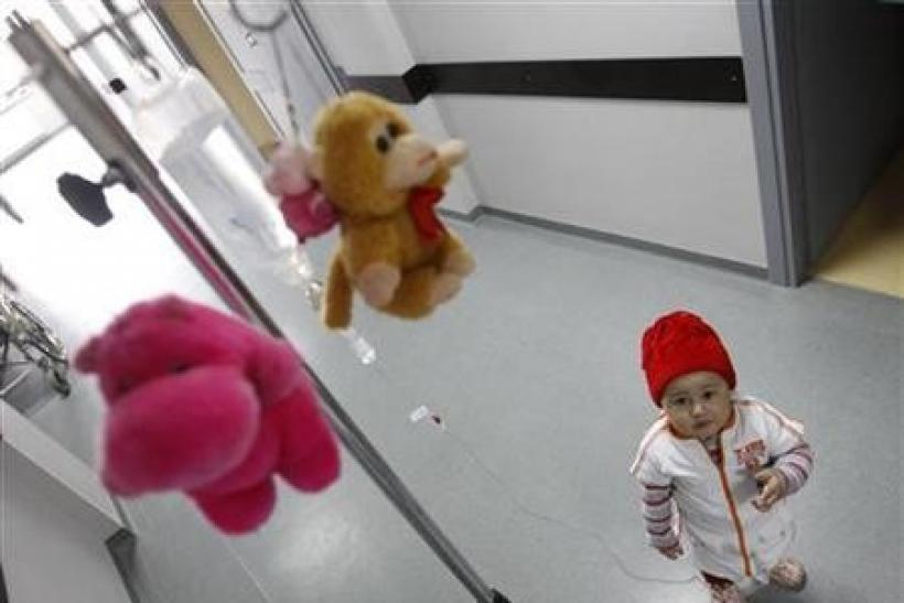 Mari, a 3 year-old leukaemia patient, stands next to her IV drip at the corridor of the onco-hematology department of the Iashvili Central Children's Hospital in Tbilisi