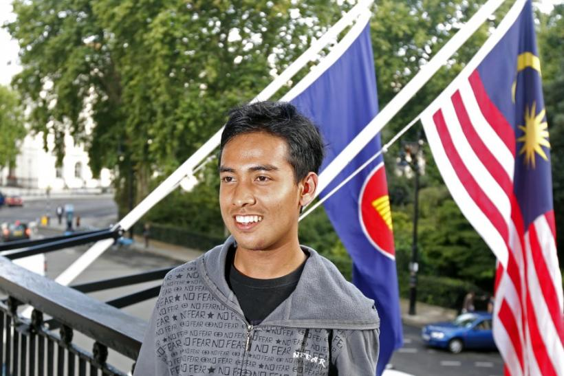Malaysian student Asyraf Haziq Rosli, who was attacked during the London riots poses for photographs at the Malaysian High Commission in London