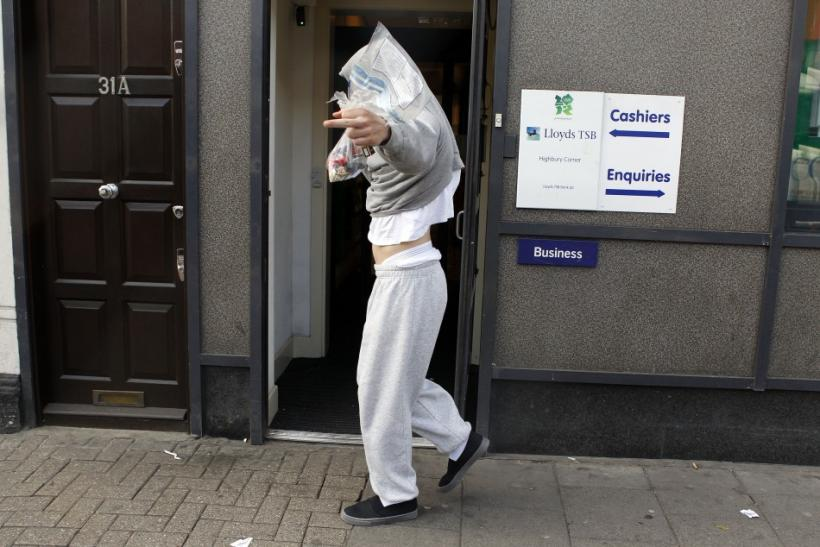 A youth makes a rude gesture as he leaves Highbury Magistrates court where he appeared over his alleged involvement in the trouble in London August 10, 2011
