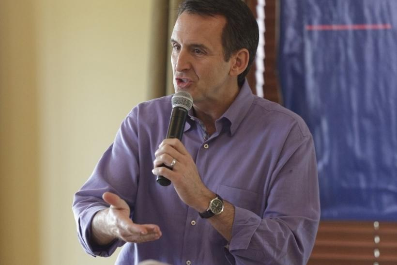 Former Minnesota Governor Pawlenty speaks at a town hall meeting at the Otter Creek Golf Course in Ankeny