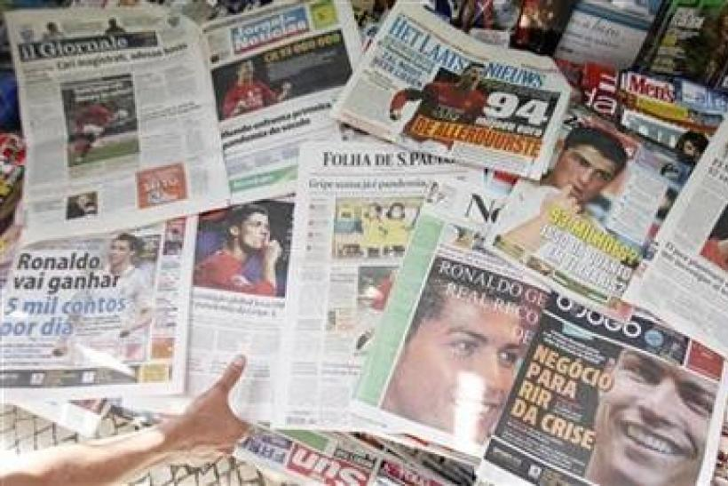 Newspapers featuring Portuguese striker Cristiano Ronaldo on their front pages are displayed in Lisbon