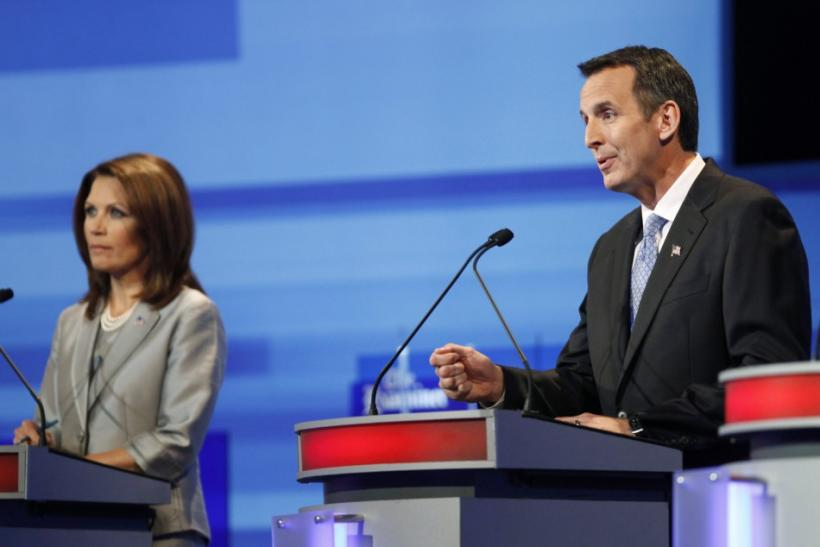 U.S. Republican presidential candidate Tim Pawlenty speaks beside Michele Bachmann during the Republican presidential debate in Ames