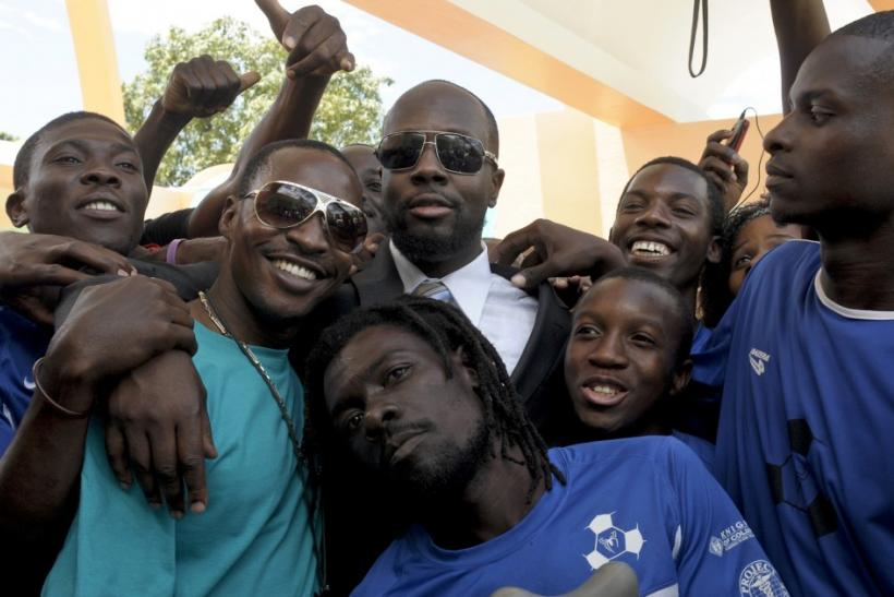 Wyclef Jean stands with members of an amputee soccer team during a ribbon cutting ceremony in Port-au-Prince