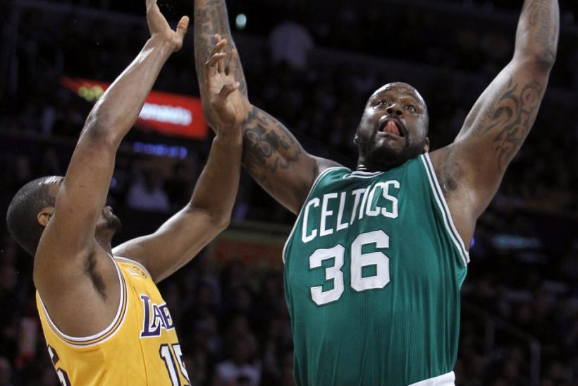 Boston Celtics center O'Neal pulls down a rebound against Los Angeles Lakers forward Artest in the first half of their NBA basketball game in Los Angeles