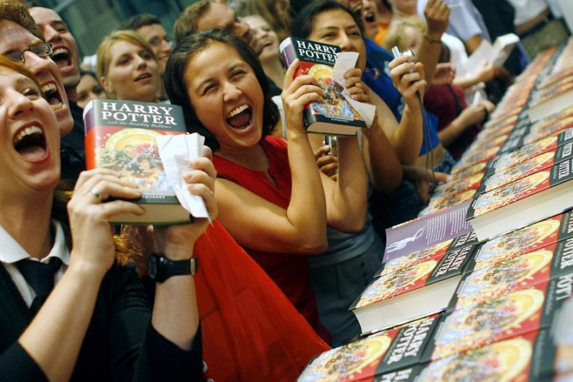 "Fans of the Harry Potter book series pose for media at the start of the sales of J.K. Rowling's ""Harry Potter and the Deathly Hallows"" in Berlin"