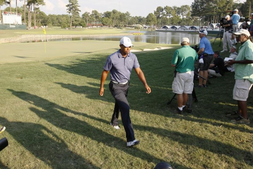 Tiger Woods of the U.S. walks off the 18th green after finishing play in the second round of the 93rd PGA Championship golf tournament at the Atlanta Athletic Club in Johns Cree