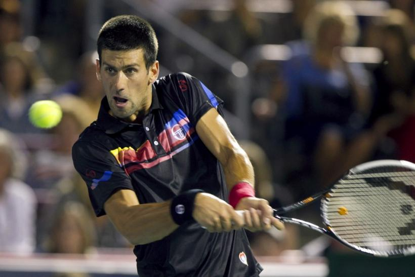 Serbia's Novak Djokovic hits a return to France's Jo-Wilfried Tsonga during his semi-final match at the Rogers Cup tennis tournament in Montreal