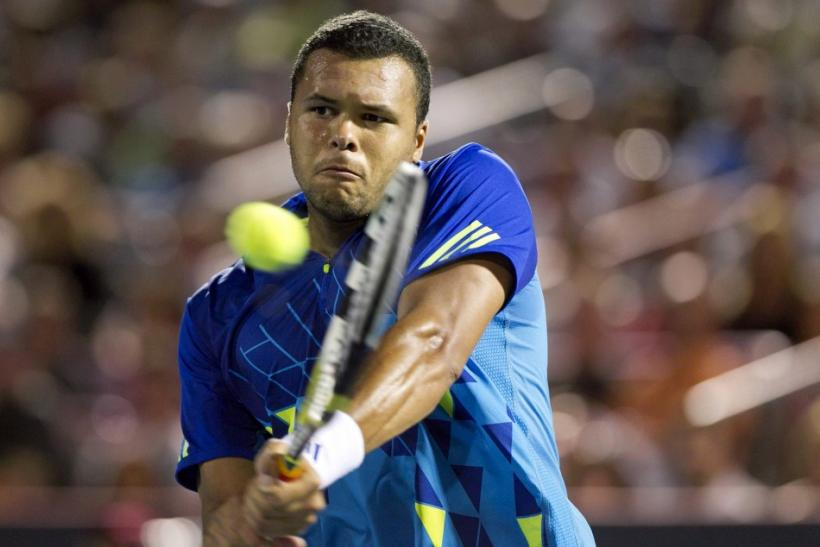 France's Jo-Wilfried Tsonga hits a return to Serbia's Novak Djokovic during his semi-final match at the Rogers Cup tennis tournament in Montreal