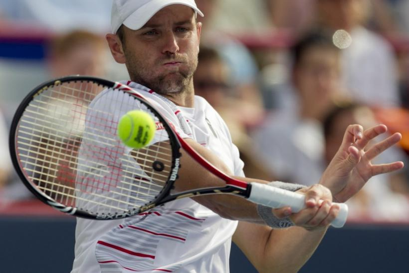 Fish of U.S. hits return to Serbia's Tipsarevic during semi-final match at the Rogers Cup tennis tournament in Montreal
