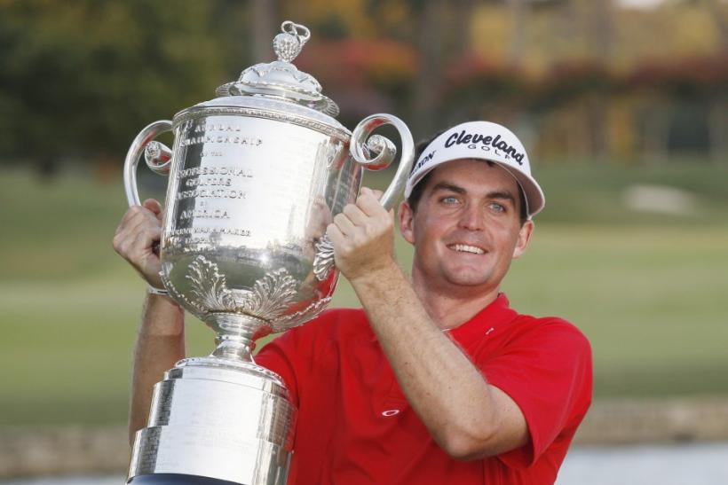 Keegan Bradley of the U.S. holds the Wanamaker Trophy after he won the 93rd PGA Championship golf tournament at the Atlanta Athletic Club in Johns Creek