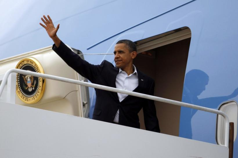 U.S. President Barack Obama steps aboard Air Force One