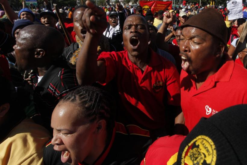 Striking South African municipal workers march through the streets of Cape Town