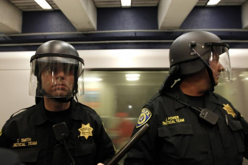 Police stand guard at a train platform during a demonstration at the BART Civic Center Station in San Francisco
