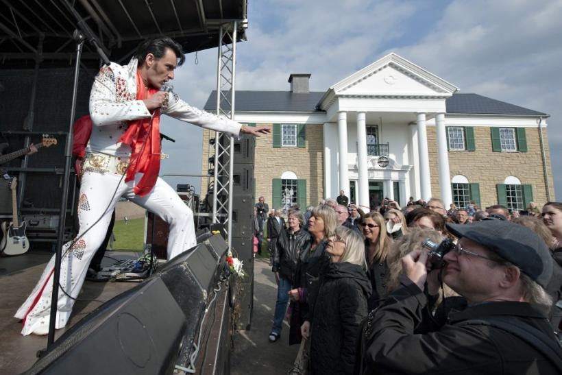 An Elvis Presley impersonator performs in front of Graceland Randers before its opening in Randers, Denmark
