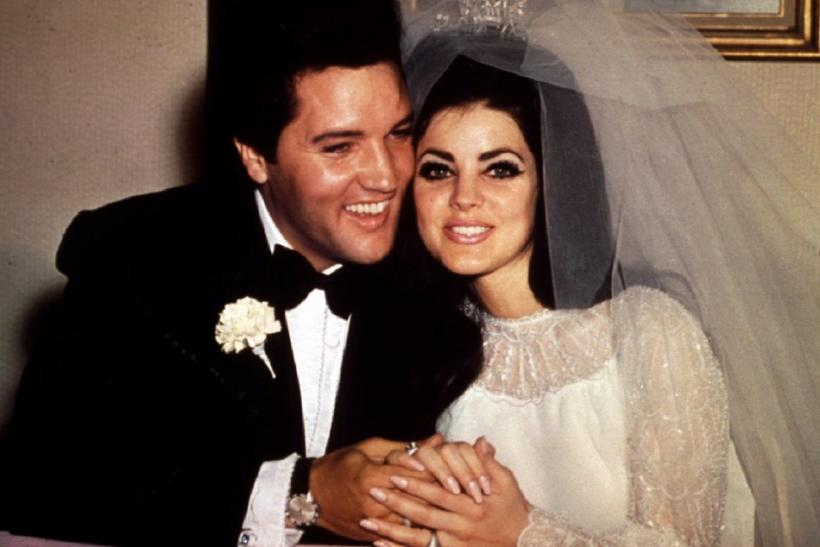 Entertainer Elvis Presley sits cheek to cheek with his bride, the former Priscilla Ann Beaulieu, fol..