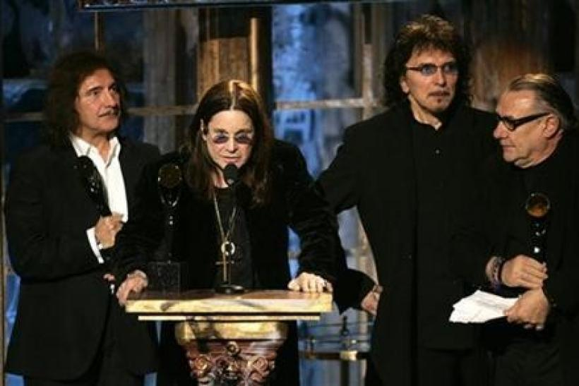 Members of the band Black Sabbath Tommy Iommi, Ozzy Osbourne, Geezer Butler and Bill Ward (L-R) react after being inducted into the Rock and Roll Hall of Fame at the 2006 Rock and Roll Hall of Fame induction ceremony at the Waldorf Astoria Hotel in New Yo