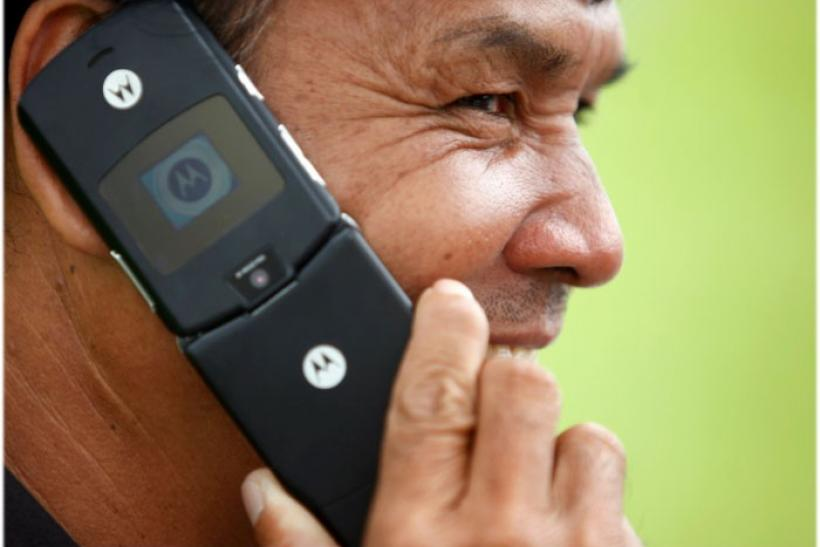 A man uses his Motorola mobile phone