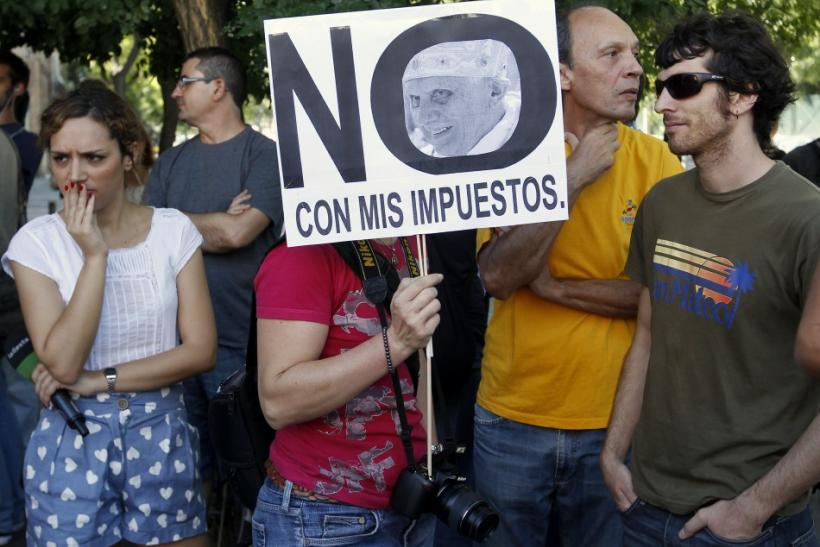 Demonstrators protest against special reductions on public transport for visiting pilgrims on the first day of the World Youth Day meeting in Madrid