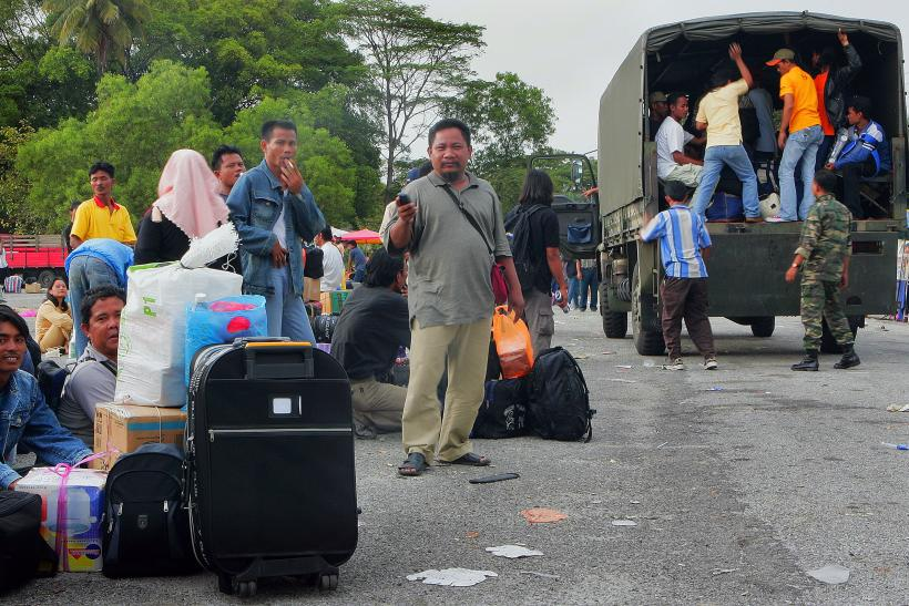 Indonesian illegal immigrants wait before being transported to a jetty at Port Klang, outside Kuala Lumpur.