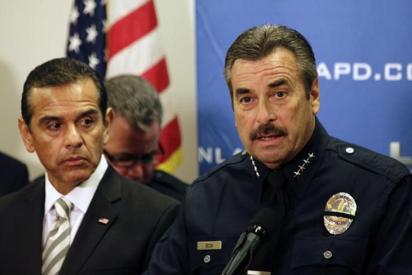 LAPD Police Chief Charlie Beck (R) speaks as Los Angeles Mayor Antonio Villaraigosa