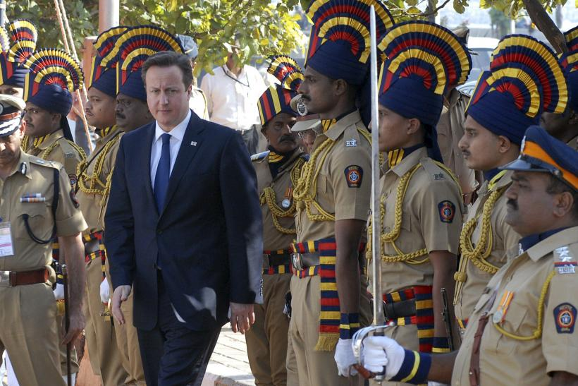 Britain's Prime Minister David Cameron arrives to pay tributes at a memorial dedicated to policemen who lost their lives in November 2008 attacks, in Mumbai February 18, 2013.