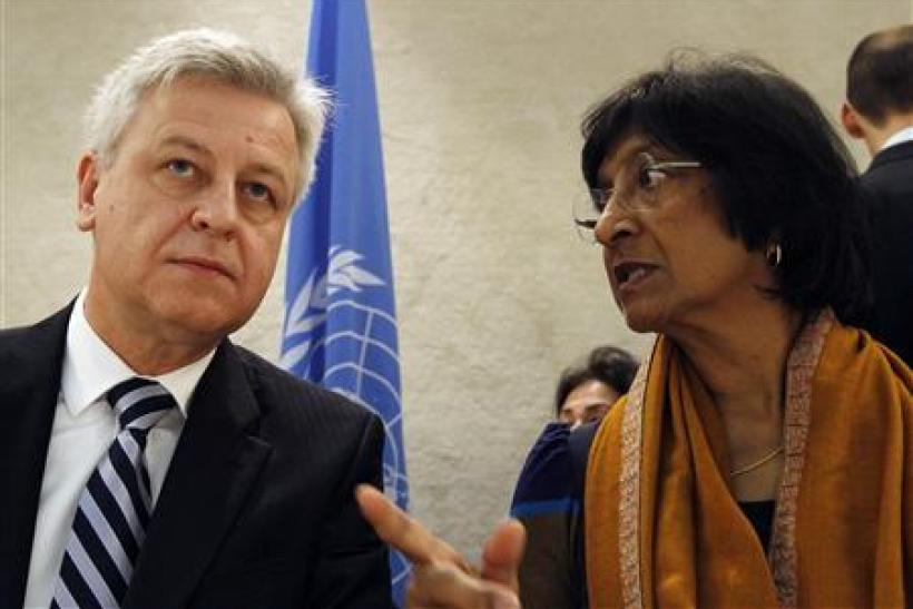 Remigiusz Henczel of UNHCR and Navi Pillay of U.N. High Commission for Human Rights