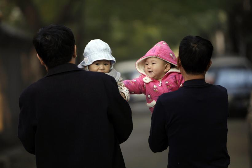 Babies With Families In Hutong, Central Beijing