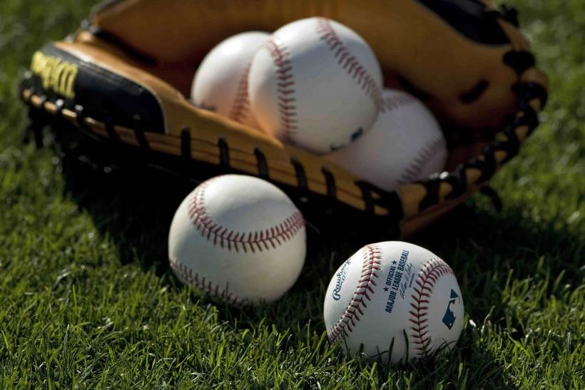 Baseballs and a Catcher's Mitt
