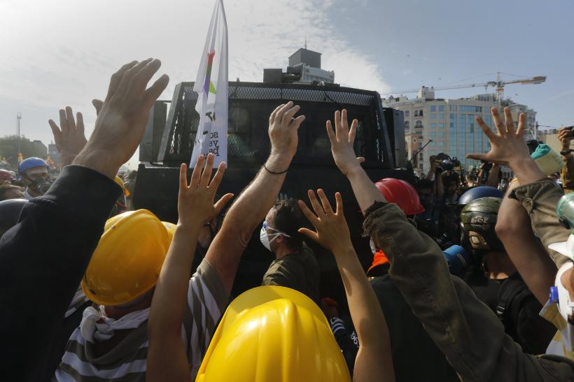 Protesters Stop Water Cannon Vehicle