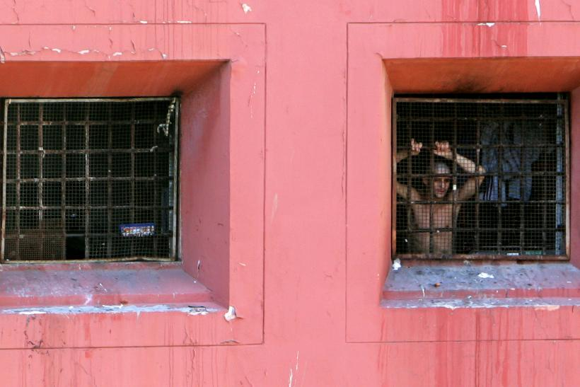 A prisoner appears in the window of Regina Coeli jail in Rome/