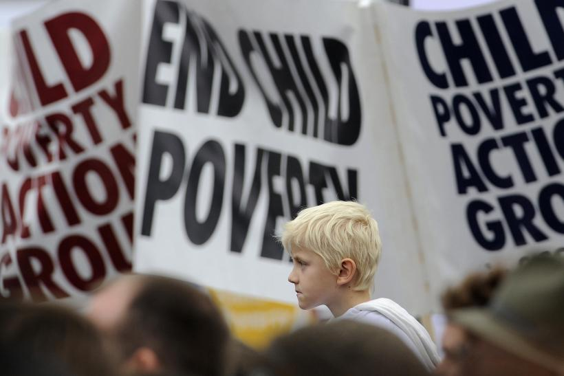 Demonstrators listen to speakers at a rally in Trafalgar Square in central London
