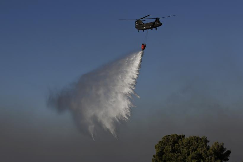 Greek Firefighting Helicopter Drops Water Over A Forest Fire At Varibobi  Suburb North Of Athens August 6, 2012. Photo: REUTERS/Yorgos Karahalis ...