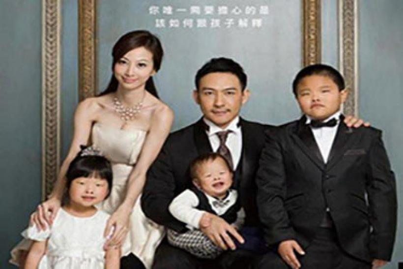 Is this family portrait the picture of the man who sued his wife for having an 'ugly' child?