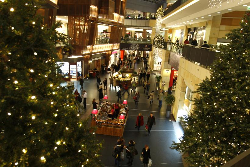 holiday shopping germany 2011 holiday shoppers walk through a mall photo reuters stores open christmas eve - What Stores Are Open On Christmas Day