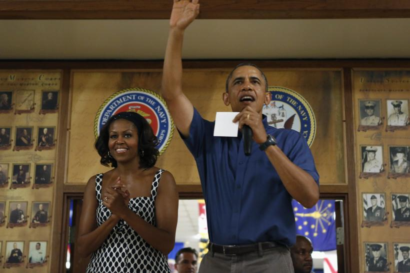 U.S. President Barack Obama (R) and first lady Michelle Obama