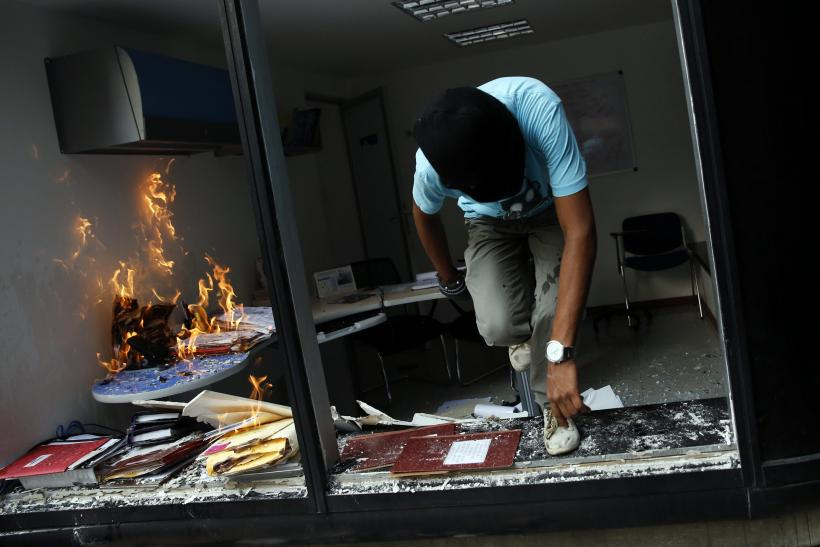 Venezuela Protester Torches Office March 12