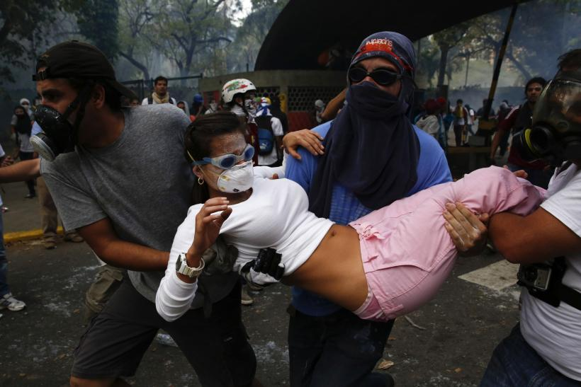 Venezuela Protesters Carry Woman March 12