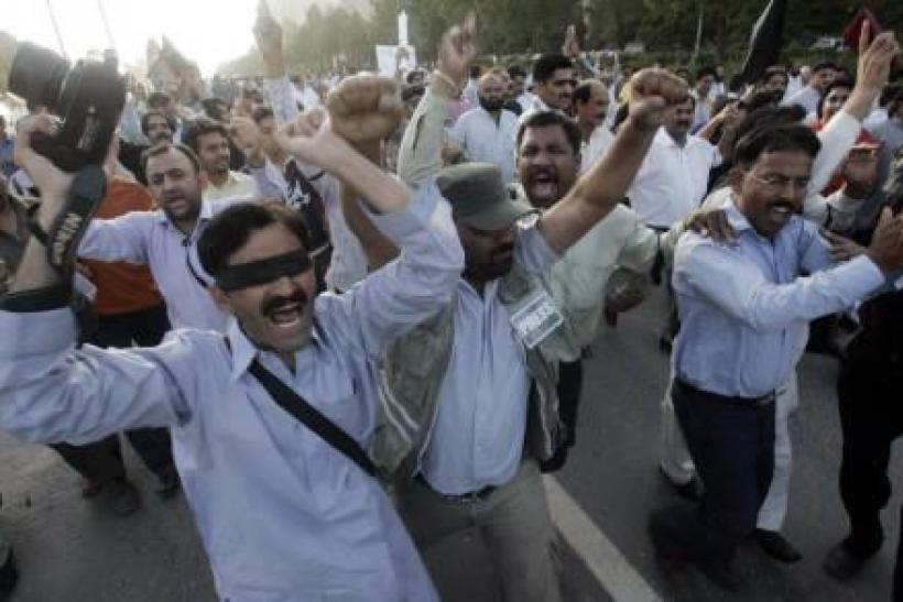 Pakistani journalists chant slogans as they march during a protest in Islamabad.
