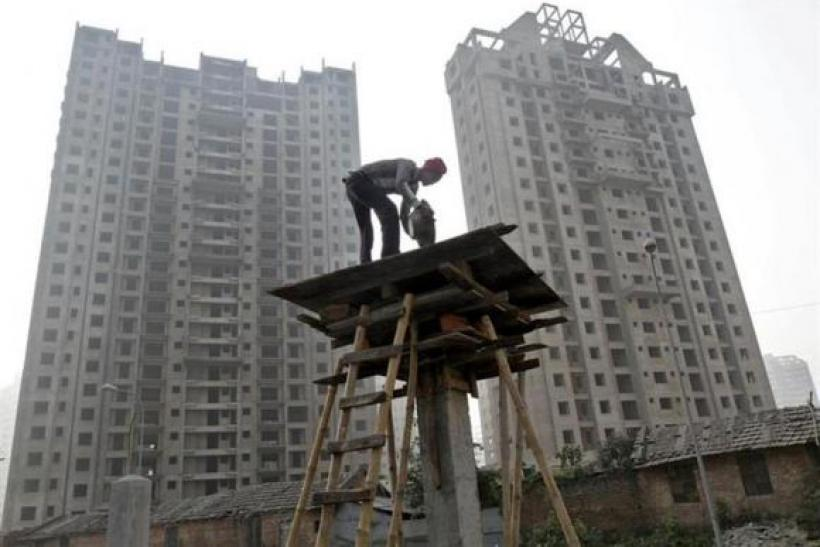 A labourer works at the construction site of a residential complex in Kolkata