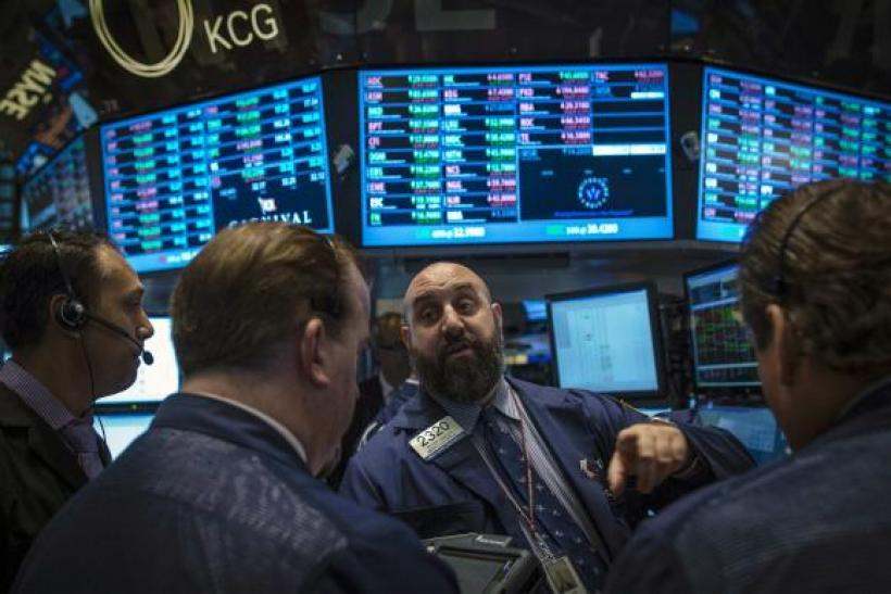 Traders work on the floor of the New York Stock Exchange, October 3, 2013.